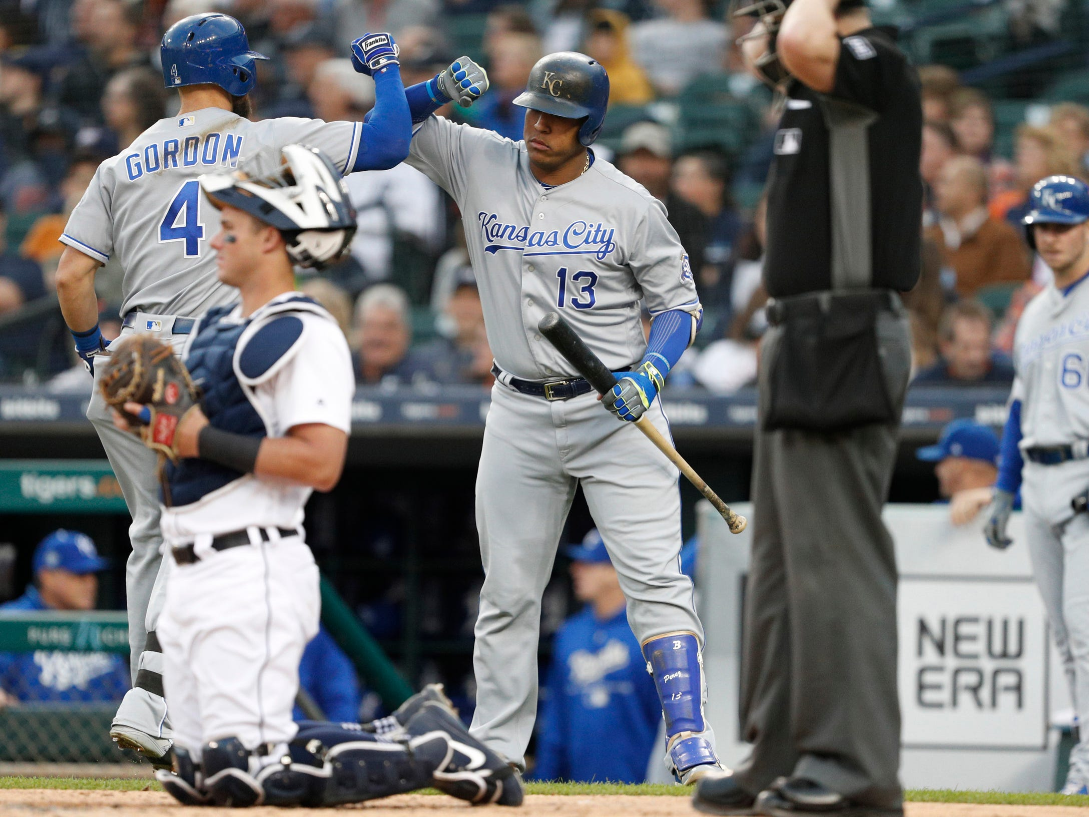 Kansas City Royals left fielder Alex Gordon celebrates with Salvador Perez (13) after hitting a solo home run during the fourth inning against the Detroit Tigers at Comerica Park on Sept. 22, 2018.