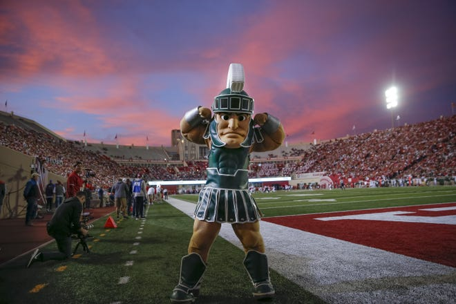 The Michigan State mascot Sparty flexes during the game against Indiana at Memorial Stadium on Saturday, Sept. 22, 2018 in Bloomington, Ind.