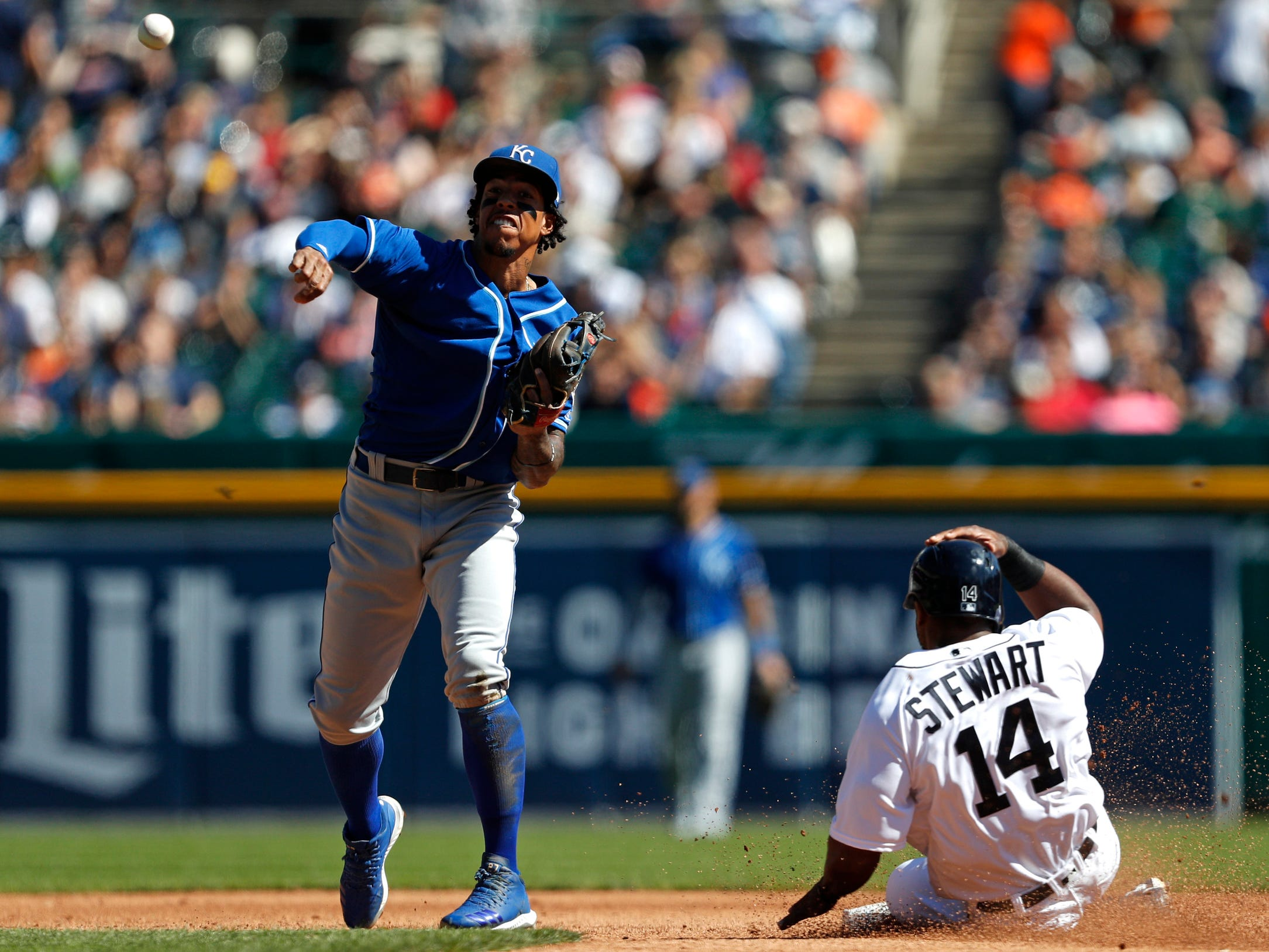 Kansas City Royals second baseman Adalberto Mondesi makes a throw to first base for an out during the fourth inning as Tigers designed hitter Christin Stewart slides into second base on Sunday, Sept. 23, 2018, at Comerica Park.