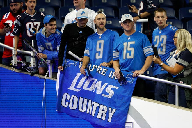 Lions fans display a sign before a game against the Patriots at Ford Field on Sept. 23.