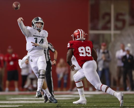 Michigan State's Brian Lewerke throws the ball as Indiana's Allen Stallings IV defends during the first quarter Sept. 22, 2018 in Bloomington, Ind.