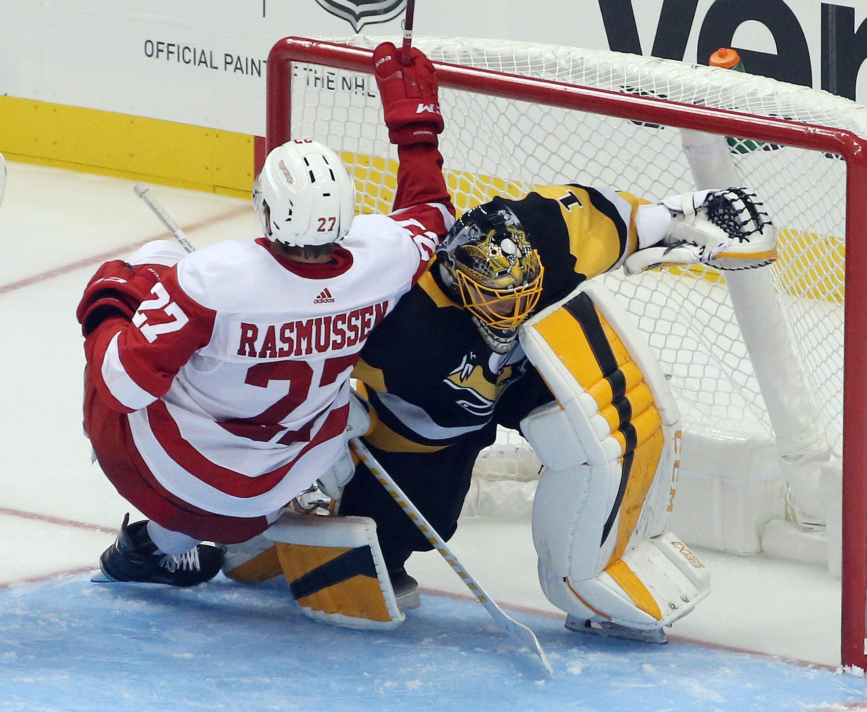 Red Wings forward Michael Rasmussen gets tangled up with Penguins goaltender Casey DeSmith during the second period of the Wings' 3-2 preseason win over the Penguins on Sunday, Sept. 23, 2018, in Pittsburgh.
