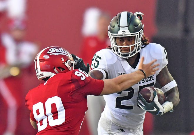 Michigan State's Darrell Stewart Jr., right, fights off Indiana's Connor Schneider for a long gain in the first quarter on Saturday.