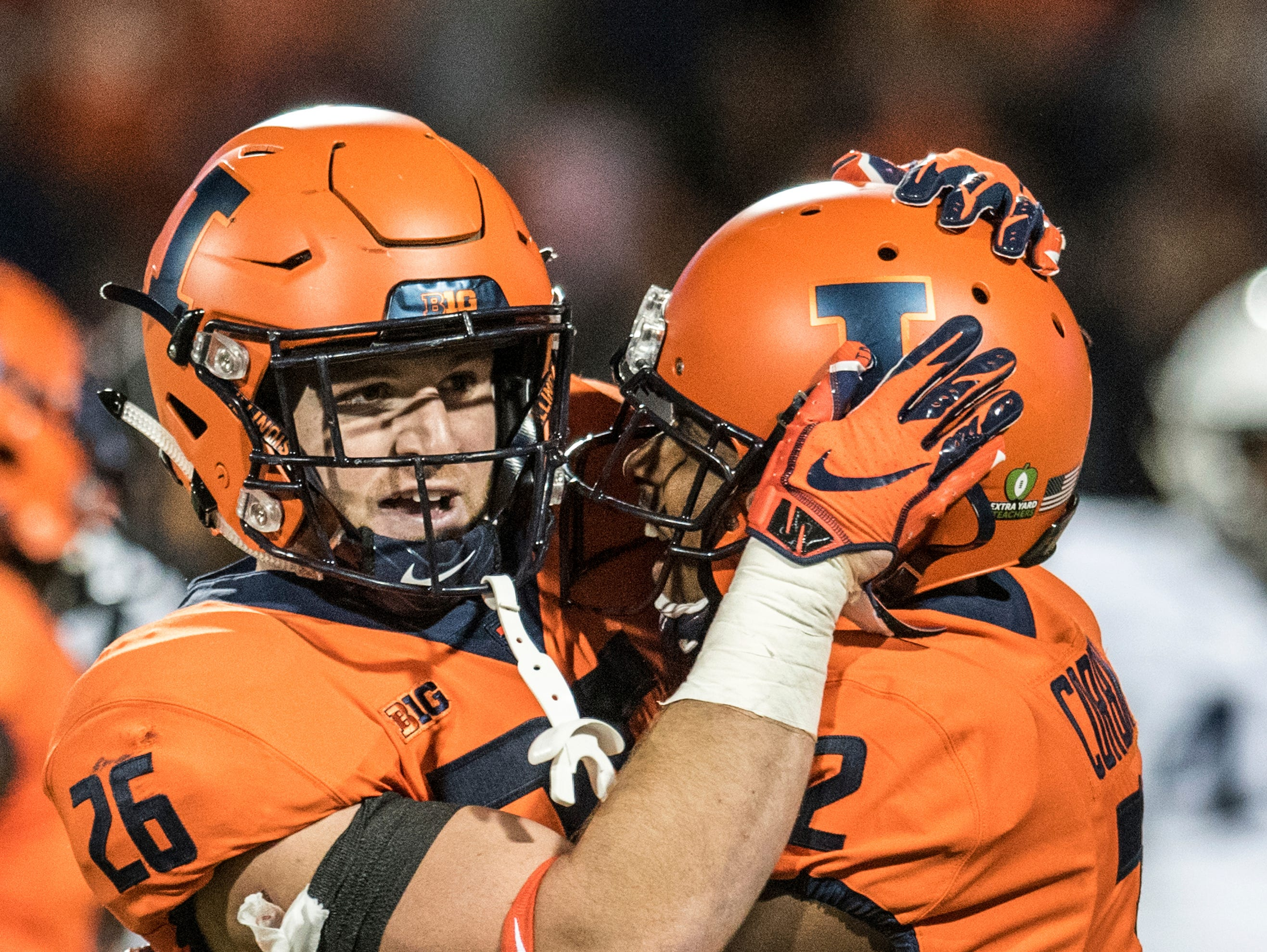 Illinois' Mike Epstein (26) and Reggie Corbin celebrate a touchdown in the first quarter against Penn State during the first half of an NCAA college football game Friday, Sept. 21, 2018, in Champaign, Ill. (AP Photo/Holly Hart)