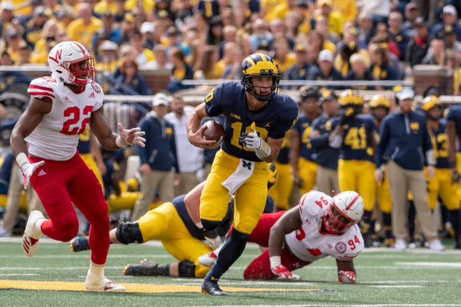 Michigan quarterback Dylan McCaffrey holds onto the ball during a third-quarter run in Saturday's win over Nebraska.