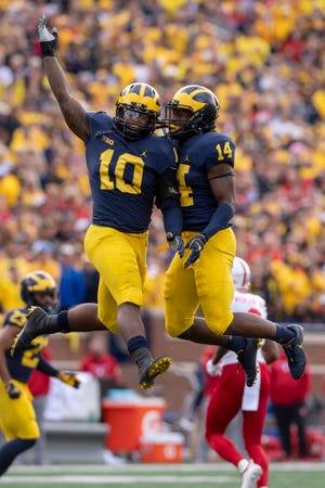 Michigan linebacker Devin Bush, left, and defensive back Josh Metellus celebrate a sack in the second quarter during Saturday's win over Nebraska.