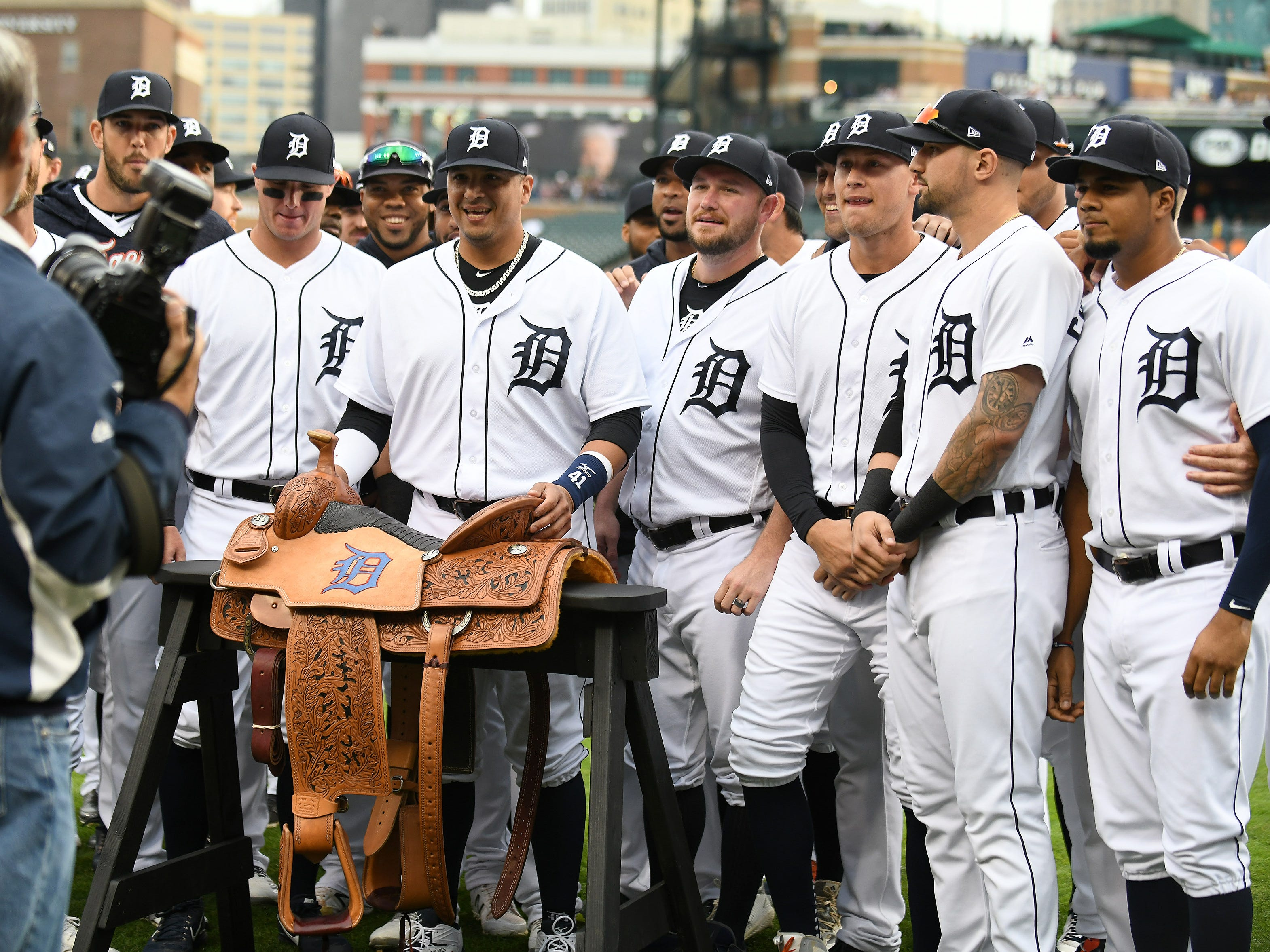 Teammates gather around Victor Martinez and his new saddle at the end of the special tribute ceremony.