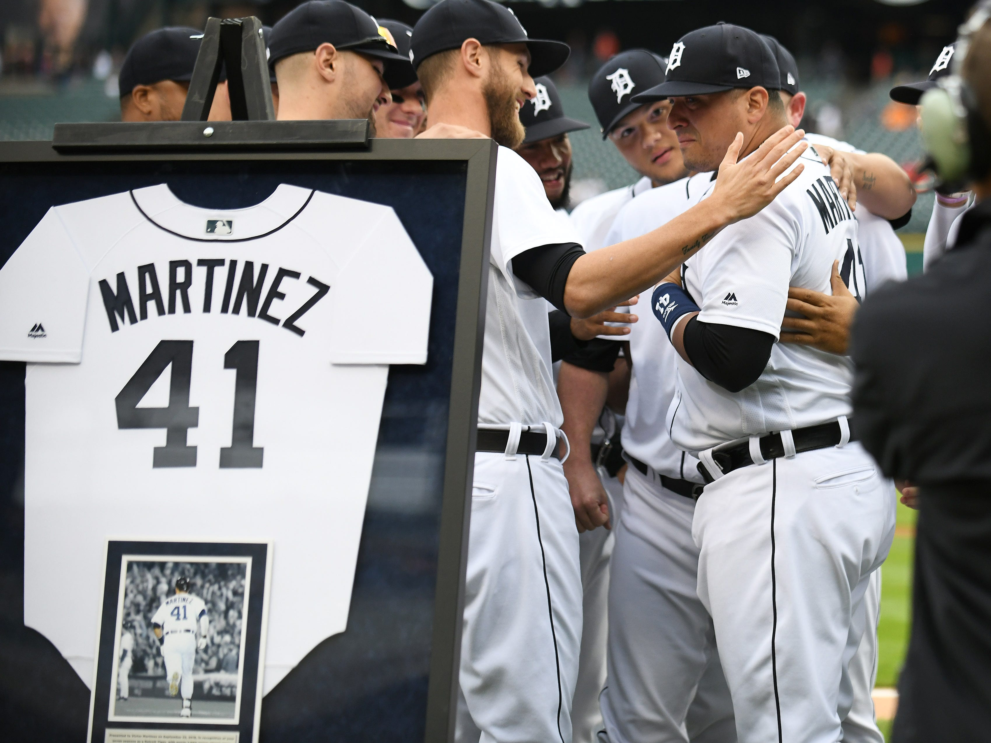 His teammates gather around Victor Martinez during the special tribute ceremony.