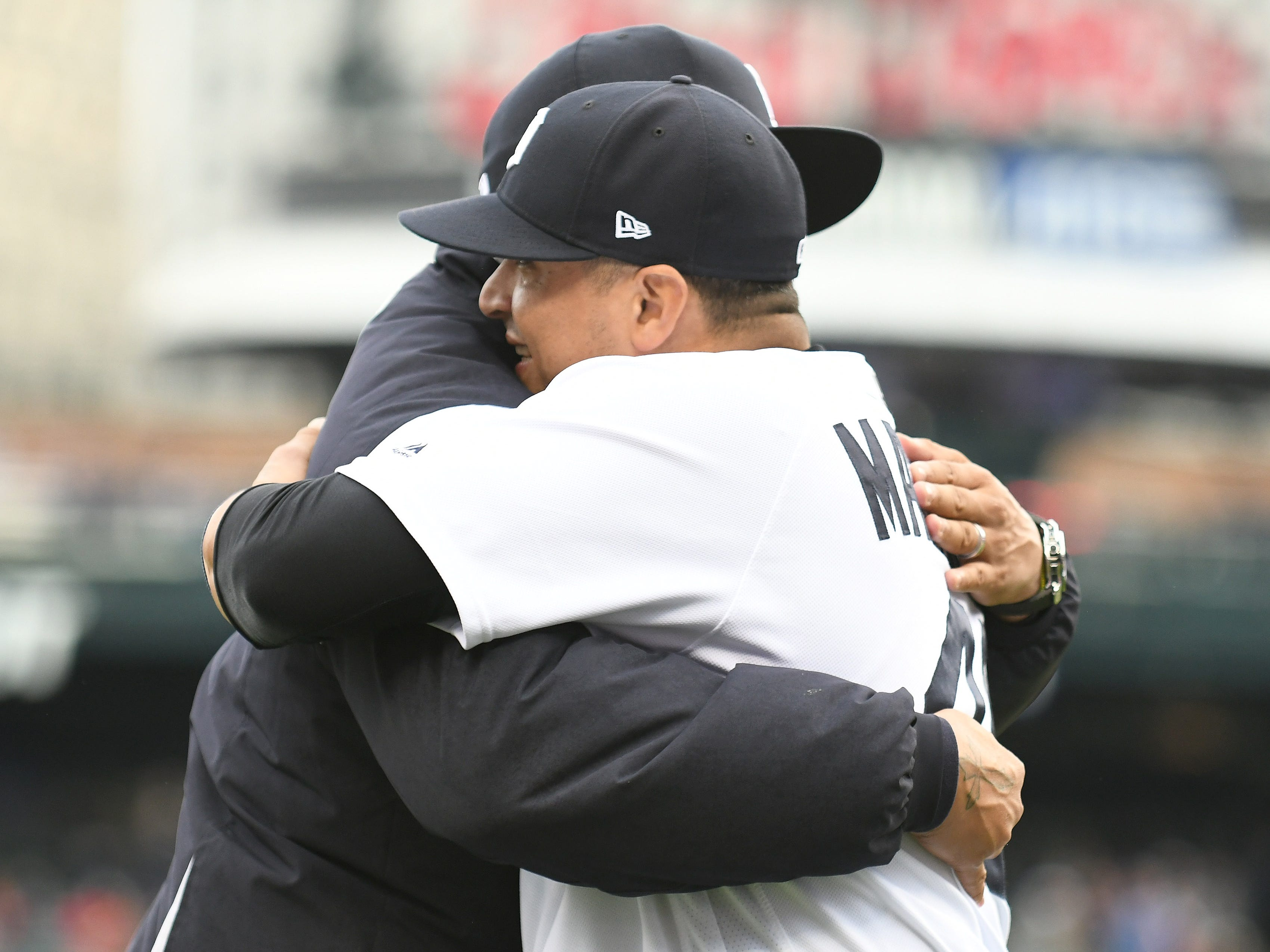 Victor Martinez hugs Miguel Cabrera during the special tribute ceremony.