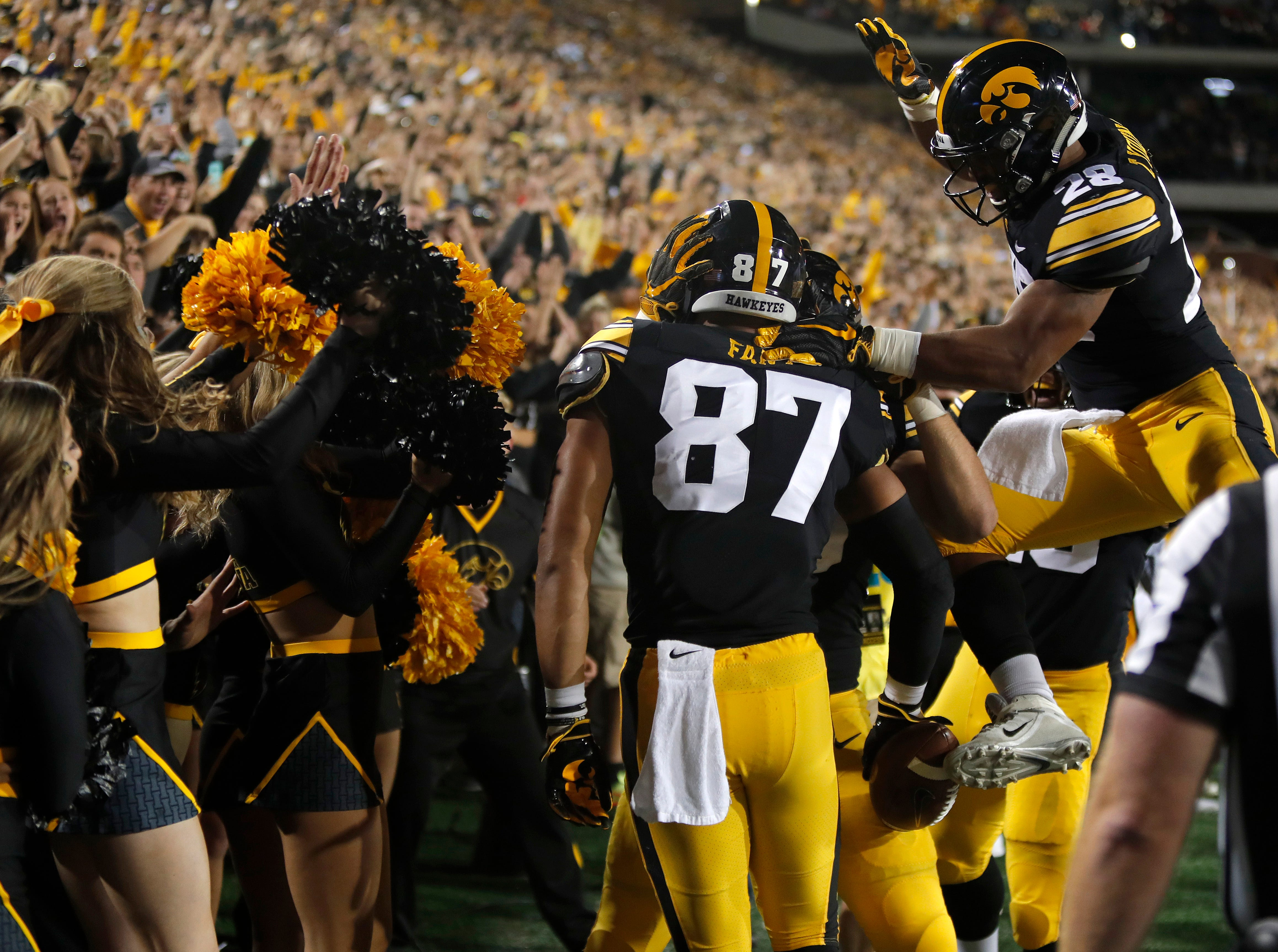 Iowa tight end Noah Fant celebrates his touchdown with Iowa running back Toren Young, right, during the second half of an NCAA college football game against Wisconsin, Saturday, Sept. 22, 2018, in Iowa City. (AP Photo/Matthew Putney)