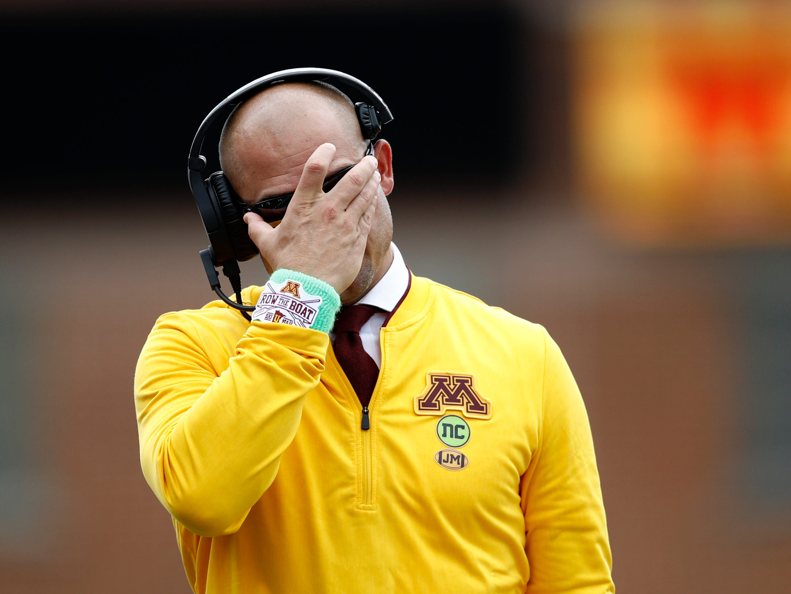 Minnesota head coach P. J. Fleck walks on the sideline in the second half of an NCAA college football game against Maryland, Saturday, Sept. 22, 2018, in College Park, Md. (AP Photo/Patrick Semansky)
