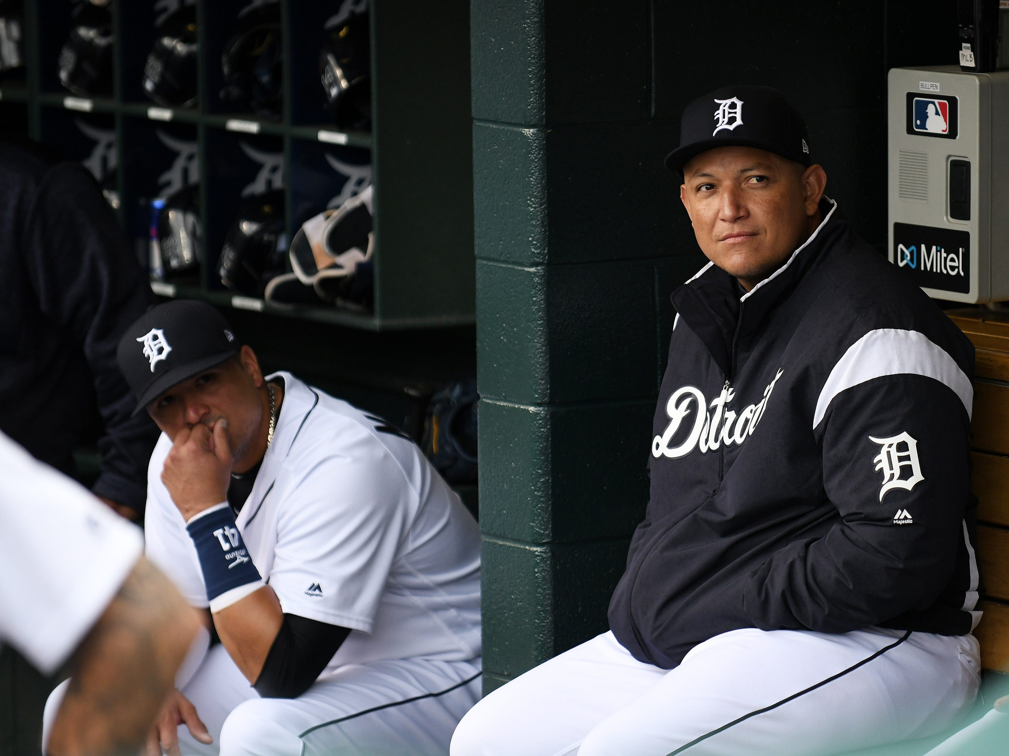 Tigers' Miguel Cabrera, right, and Victor Martinez watch video messages and footage during the ceremony.