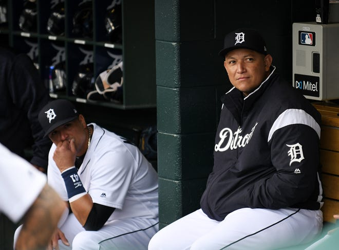Victor Martinez, left, has come off the Tigers' payroll, but Miguel Cabrera remains for a long time.