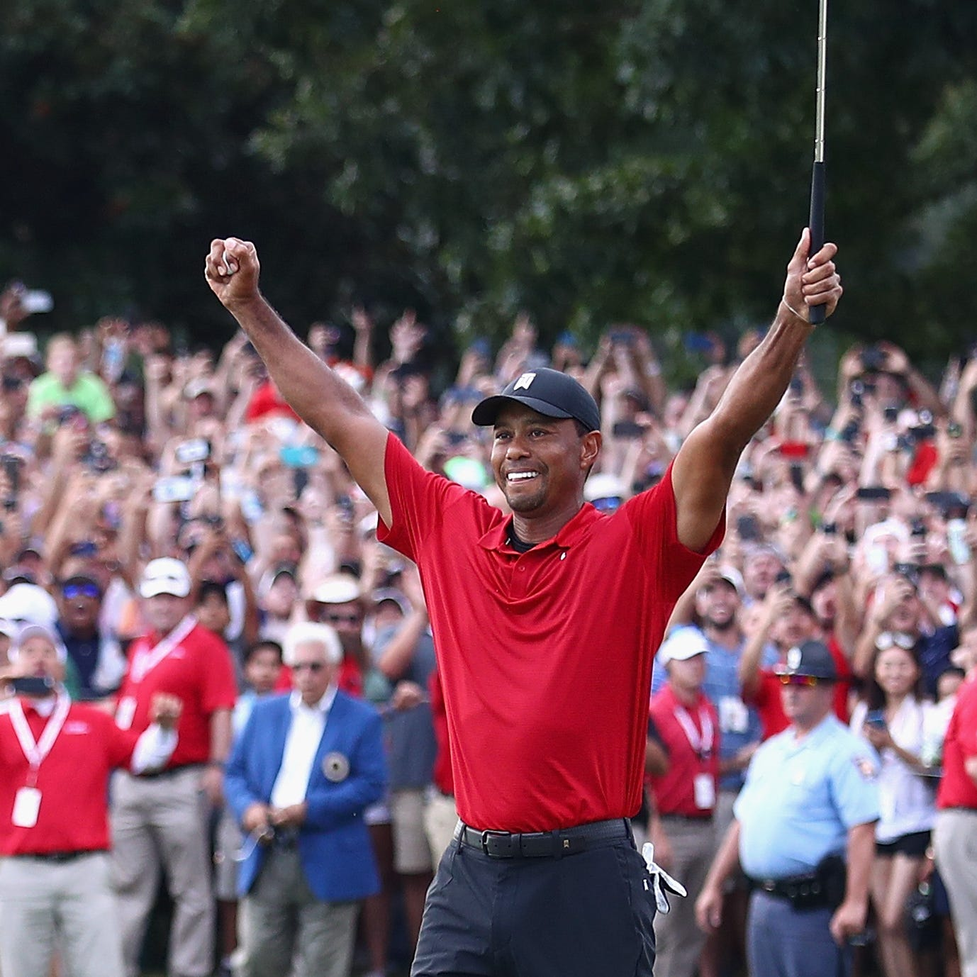 Sunday's golf: Woods caps comeback with first win in five years