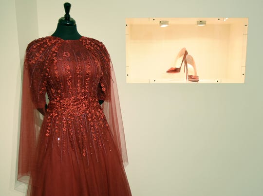 """The exhibit at the Charles H. Wright Museum of African American History features a """"tribute to the Queen of Soul."""" It features archival photographs, videos, the red shoes she wore at her first visitation and a replica of the matching red dress"""