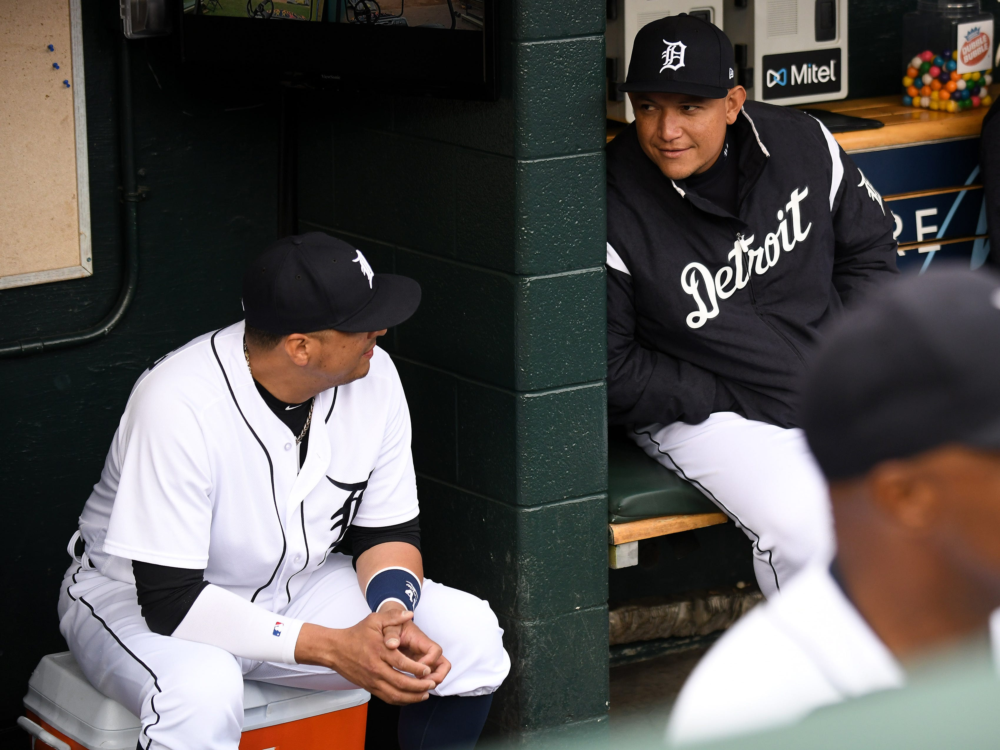 Tigers' Miguel Cabrera, right, talks with Victor Martinez before the special tribute ceremony.