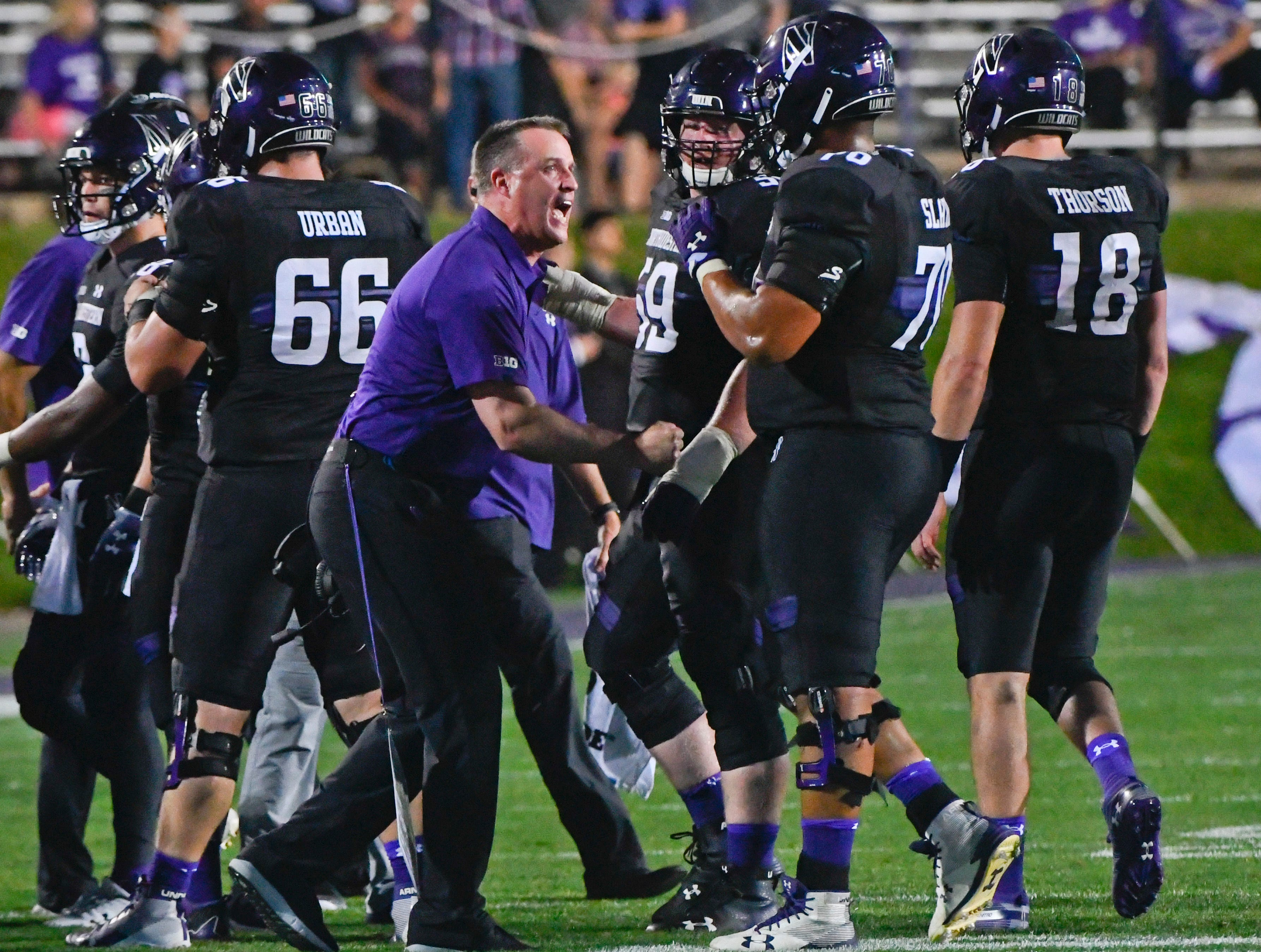 Northwestern head coach Pat Fitzgerald directs his team against Akron during the first half of an NCAA college football game in Evanston, Ill., Saturday, Sept. 15, 2018. (AP Photo/Matt Marton)