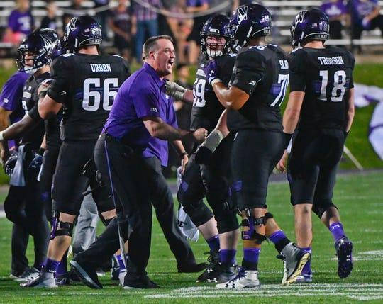 Northwestern head coach Pat Fitzgerald directs his team against Akron earlier this season.