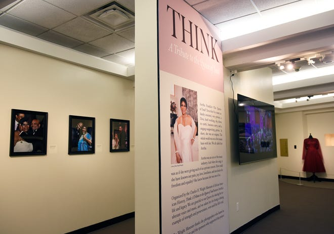 """The entrance of the """"THINK"""" exhibit with a video monitor showing interviews of Aretha Franklin."""
