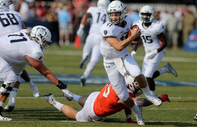 Old Dominion quarterback Blake LaRussa avoids a sack by Virginia Tech's Jerrod Hewitt during the first half.