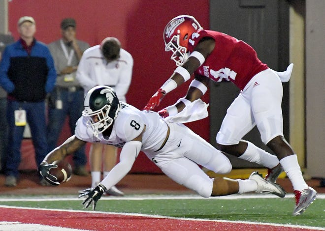 Spartan wide receiver Jalen Nailor dives over the goal line for the first touchdown of the game.