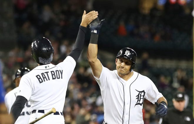 The Detroit Tigers' Mikie Mahtook is greeted at home after a two-run home run during the eighth inning.