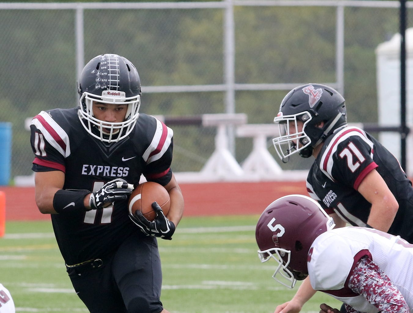 Jarrid Lewis picks up yardage for Elmira during a 30-8 victory over Syracuse Corcoran on Sept. 22, 2018 at Ernie Davis Academy.