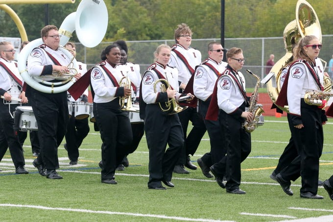 The Elmira marching band plays during the football team's 30-8 victory over Syracuse Corcoran on Sept. 22, 2018 at Ernie Davis Academy.