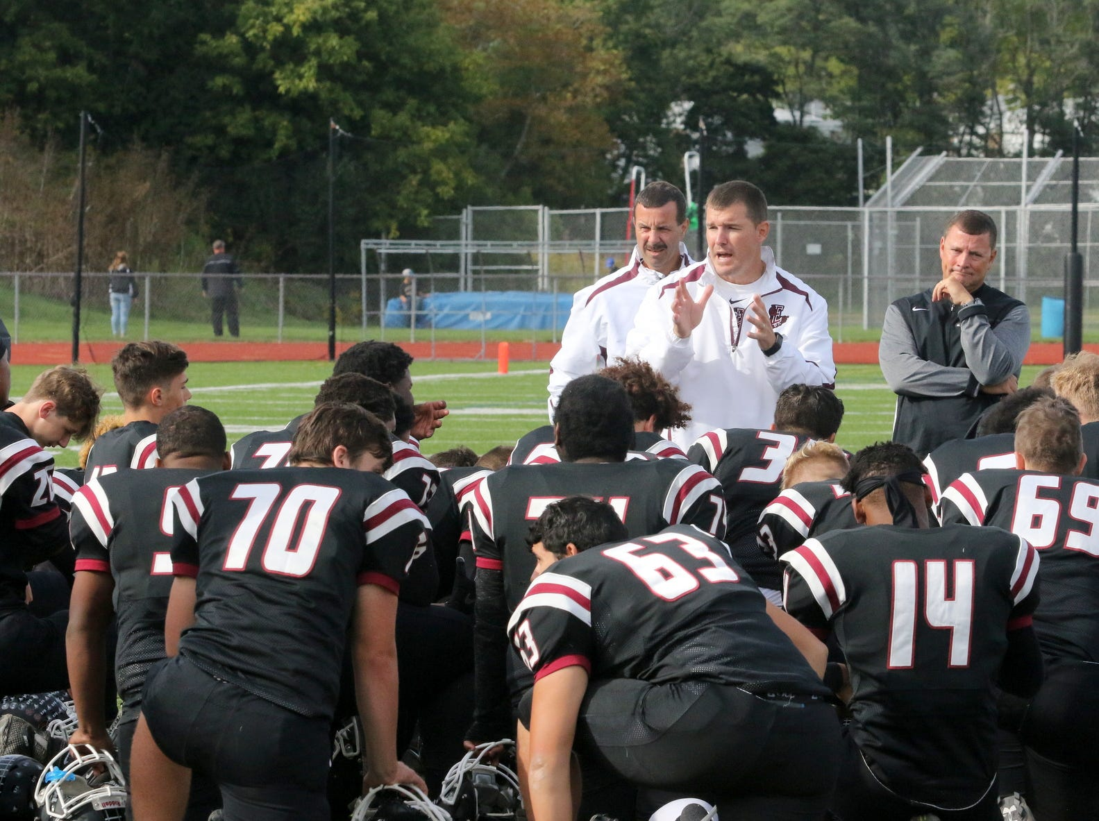Elmira head coach Jimmy McCauley talks to his players after a 30-8 victory over Syracuse Corcoran on Sept. 22, 2018 at Ernie Davis Academy.