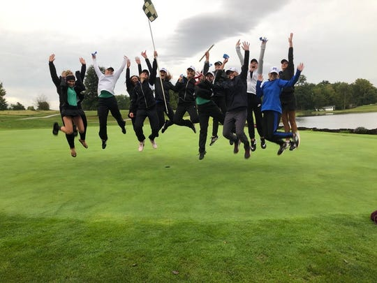 The North and Memorial golf teams celebrate after finishing 1-2 in the regional at Country Oaks on Saturday.