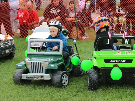 Cooper Firsdon, 5, of Fremont, drives this pint-sized Jeep on his way to a victory in the Power Wheels Demo Derby at the Clyde Fair on Saturday.
