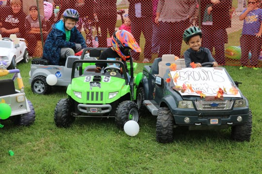 With wheels buzzing and bumpers banging, a handful of area children got the chance to jump in the driver's seat and partake in a miniature demolition derby on Saturday.