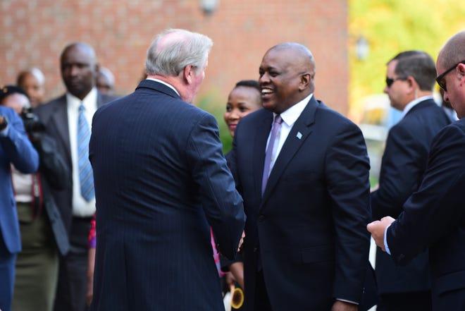 Mokgweetsi Masisi, President of the Republic of Botswana, meets with Florida State University President John Thrasher outside of the Wescott Building.