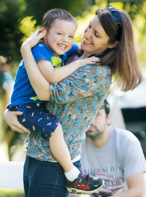 Angela Gallini dances with her son Josiah, 4, on Sunday at the Southwest Florida Peace Day Celebration at the Alliance for the Arts in Fort Myers. The annual event is part of International Day of Peace events.