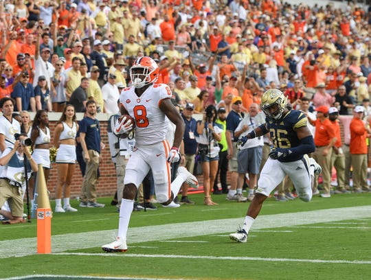 Clemson wide receiver Justyn Ross (8) scores past Georgia Tech defensive back Malik Rivera (36) during the 2nd quarter at Georgia Tech's Bobby Dodd Stadium Saturday, September 22, 2018.