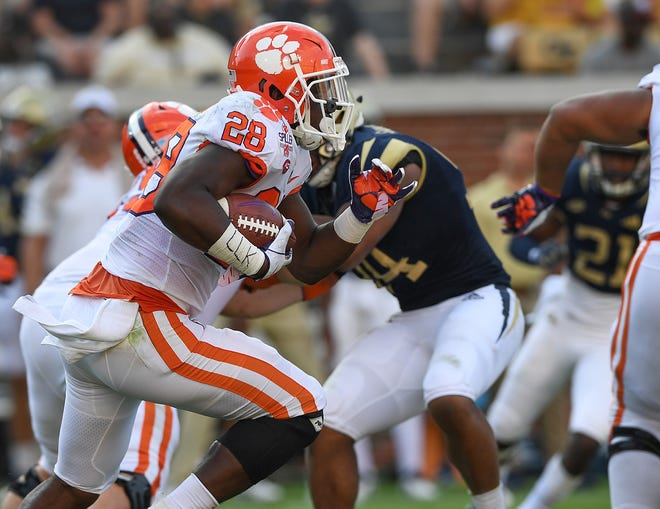 Clemson running back Tavien Feaster (28) carries against Georgia Tech during the 3rd quarter at Georgia Tech's Bobby Dodd Stadium Saturday, September 22, 2018.