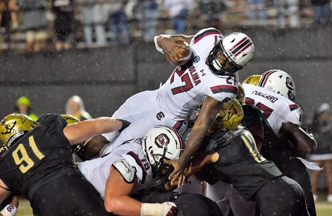 South Carolina Gamecocks running back Ty'Son Williams (27) dives over the pile for a touchdown against the Vanderbilt Commodores during the second half at Vanderbilt Stadium.