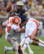 Clemson linebacker Logan Rudolph (54) forces Georgia Tech quarterback Tobias Oliver (8) to fumble during the 4th quarter at Georgia Tech's Bobby Dodd Stadium Saturday, September 22, 2018.