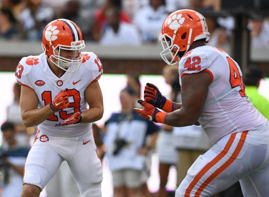 Clemson wide receiver Hunter Renfrow (13) celebrates with defensive lineman Christian Wilkins (42) after catching a TD against Georgia Tech during the 2nd quarter at Georgia Tech's Bobby Dodd Stadium Saturday, September 22, 2018.