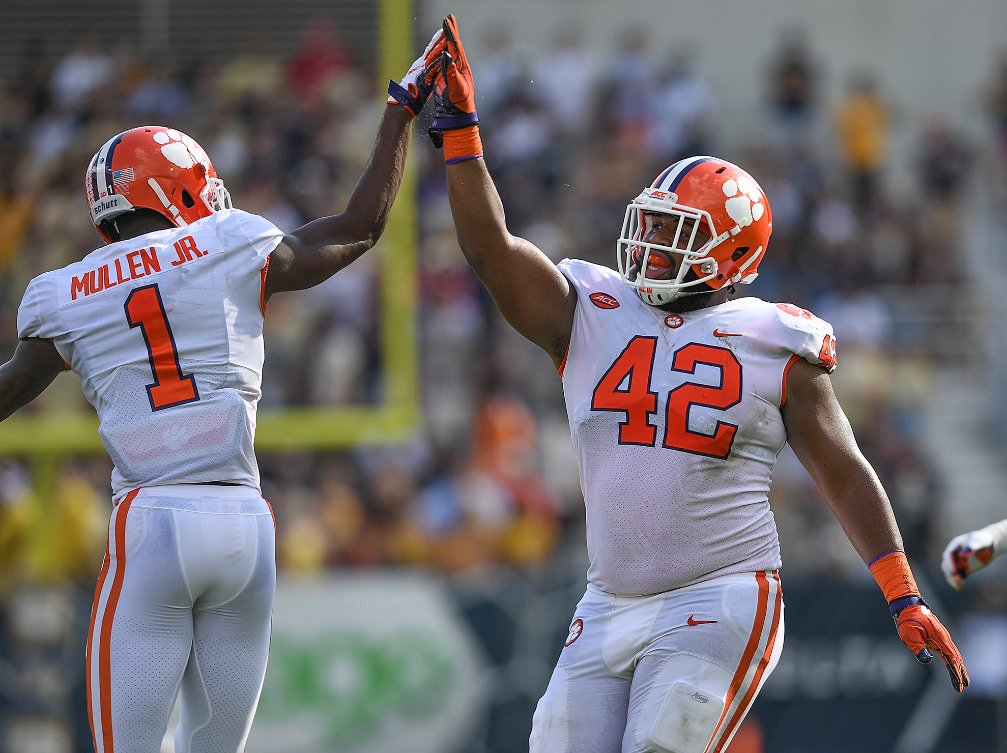 Clemson cornerback Trayvon Mullen (1)  and defensive lineman Christian Wilkins (42) celebrate a defensive stop against Georgia Tech during the 2nd quarter at Georgia Tech's Bobby Dodd Stadium Saturday, September 22, 2018.