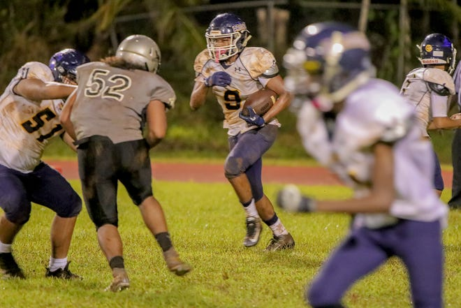 The Simon Sanchez Sharks took on the Guam High Panthers in a football match on Sept 22, 2018 at the Okkodo High School football field.  Virgilio Valencia /For PDN