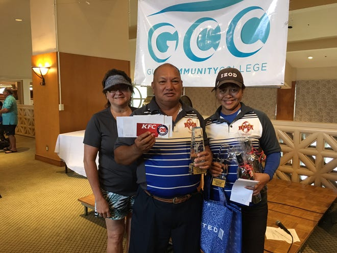 Dr. Mary Okada, Guam Community College president; Ed Castro, and Annie Borja celebrate Borja and Castro's team win with a net score of 68.6 at the GCC Foundation Par Excellence Golf Tournament at LeoPalace Resort on Sept. 22, 2018.