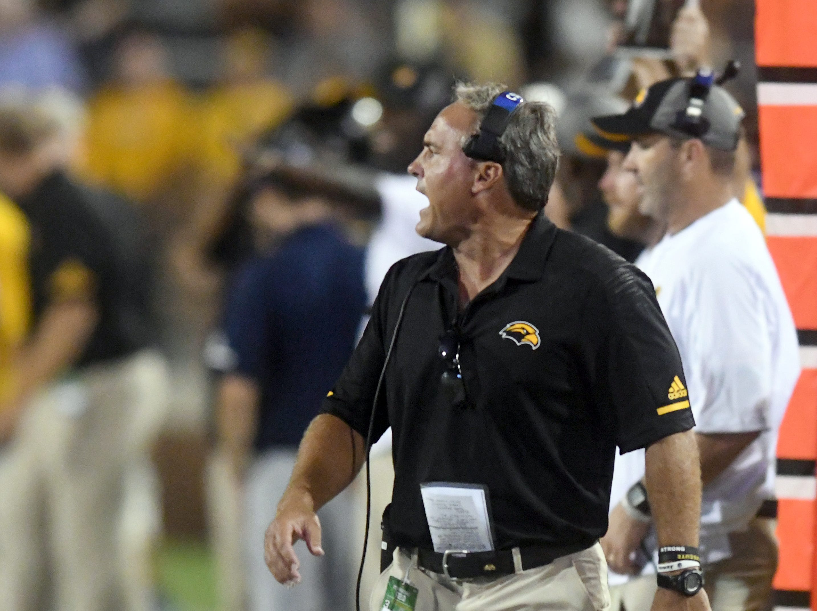 Southern Miss head coach Jay Hopson yells plays to his players in a game against Rice at M.M. Roberts Stadium on Saturday, September 22, 2018.