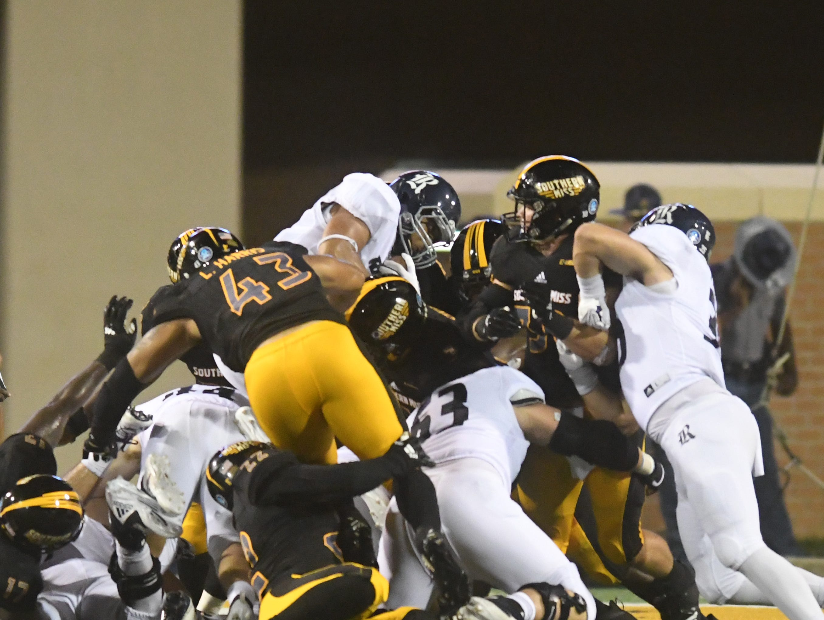 Southern Miss defense attempts to stop a play in a game against Rice at M.M. Roberts Stadium on Saturday, September 22, 2018.