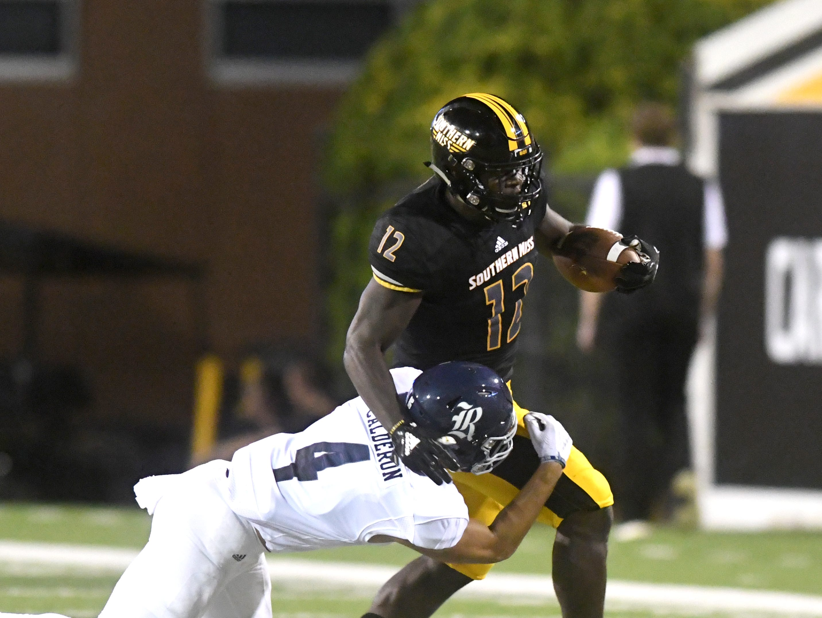 Southern Miss running back Steven Anderson carries the ball in a game against Rice at M.M. Roberts Stadium on Saturday, September 22, 2018.