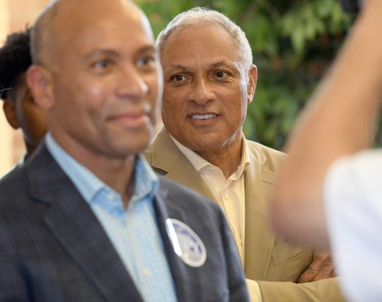 Mike Espy, a former congressman and U.S. secretary of agriculture, right, is joined by former Massachusetts Gov. Deval Patrick, left, at a campaign stop Sept. 23, 2018, at the Train Depot in Hattiesburg, Mississippi.