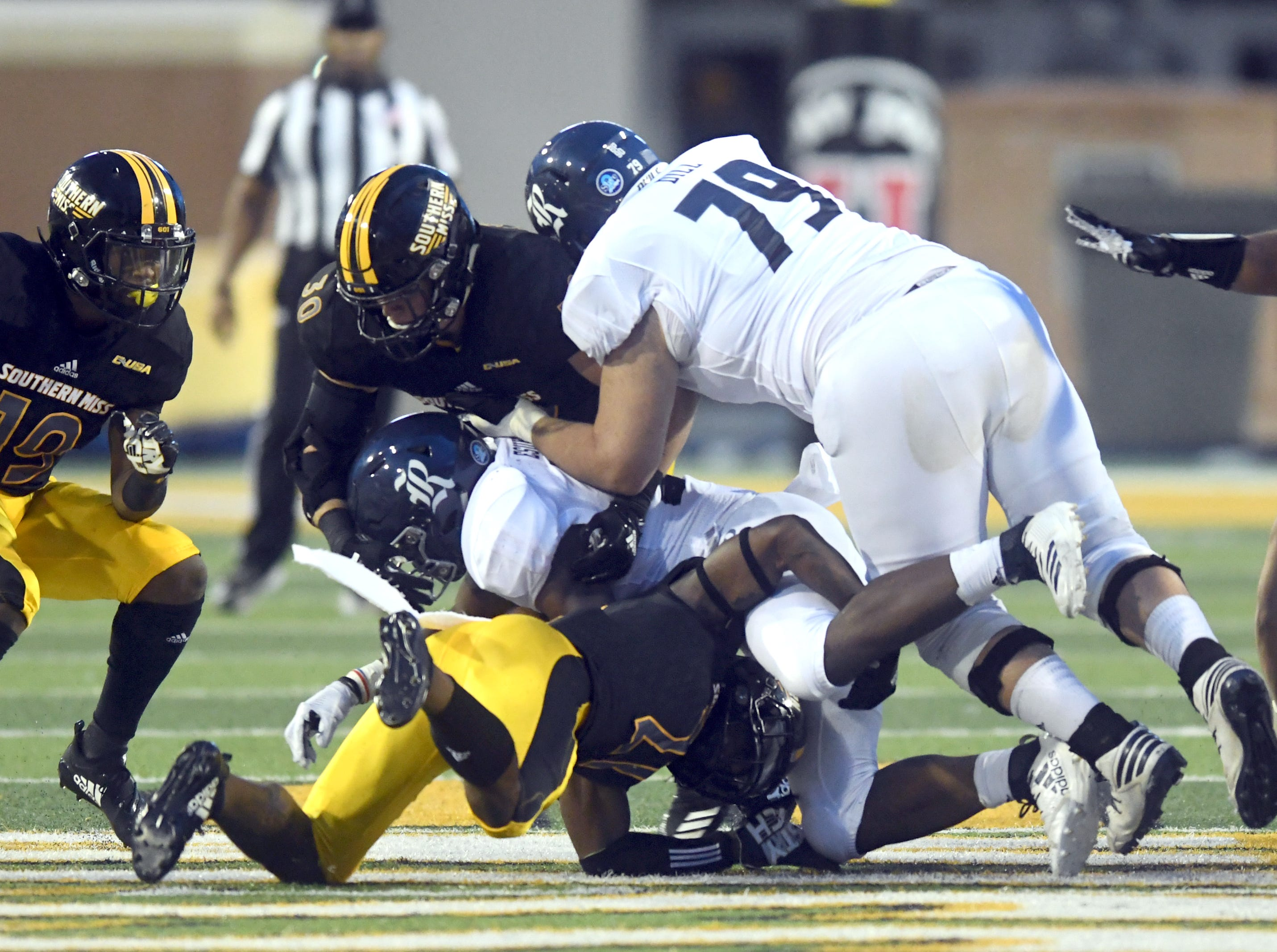 Southern Miss defensive players make a stop in a game against Rice at M.M. Roberts Stadium on Saturday, September 22, 2018.