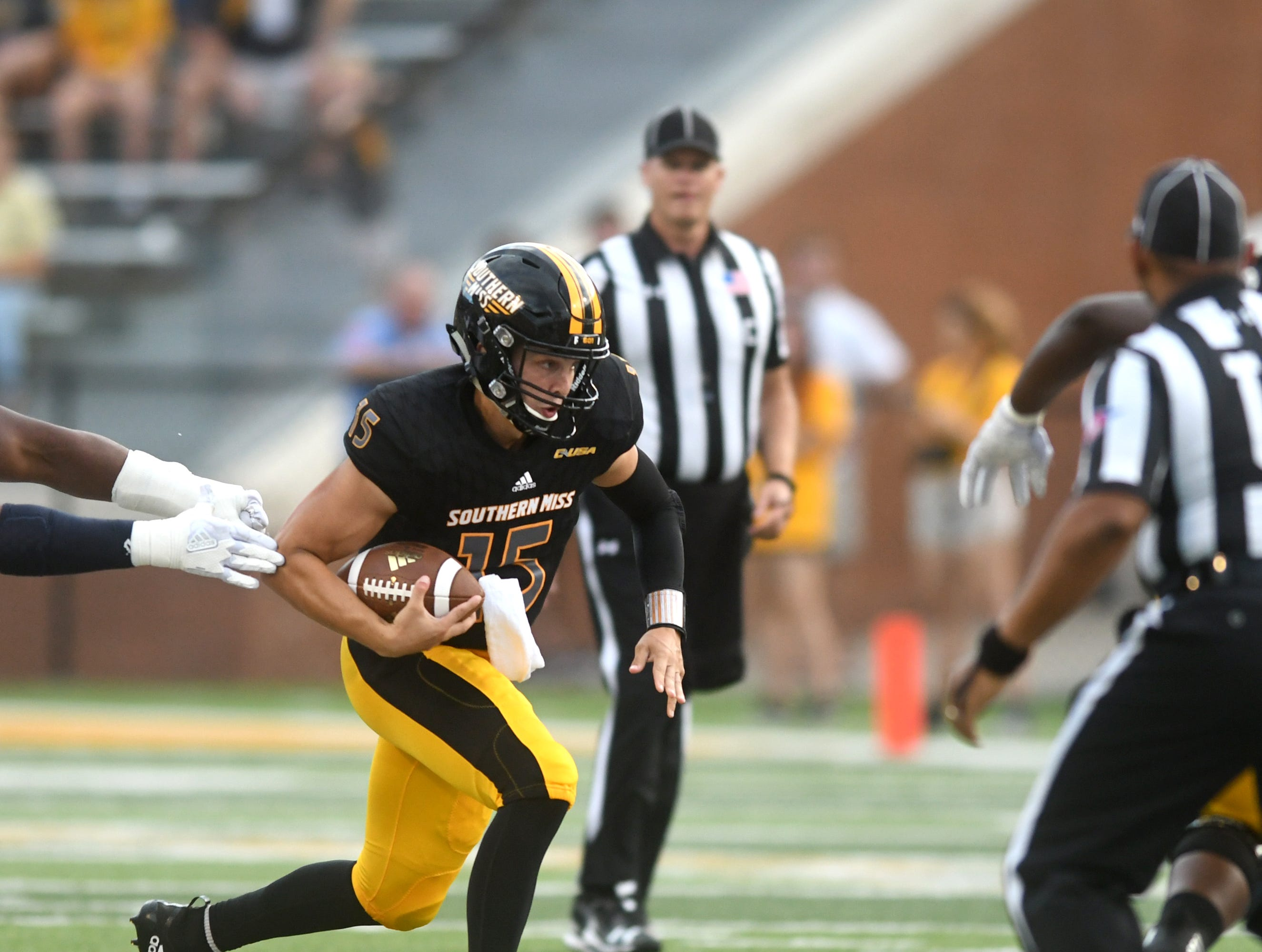 Southern Miss quarterback Jack Abraham carries the ball in a game against Rice at M.M. Roberts Stadium on Saturday, September 22, 2018.