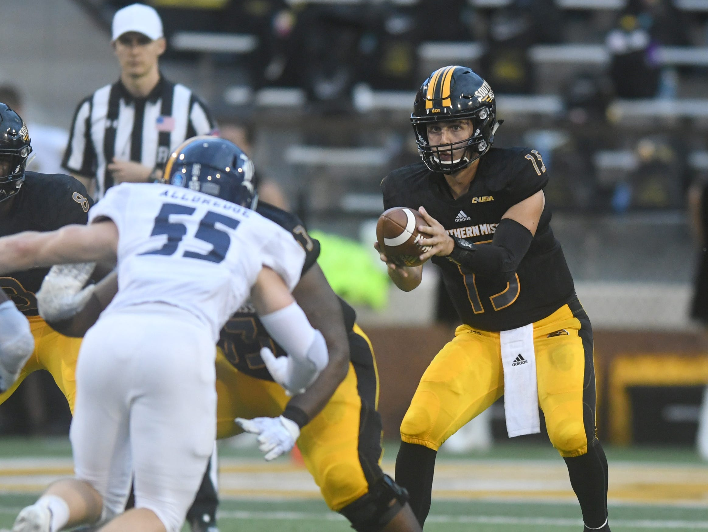 Southern Miss quarterback Jack Abraham catches a snap in a game against Rice at M.M. Roberts Stadium on Saturday, September 22, 2018.