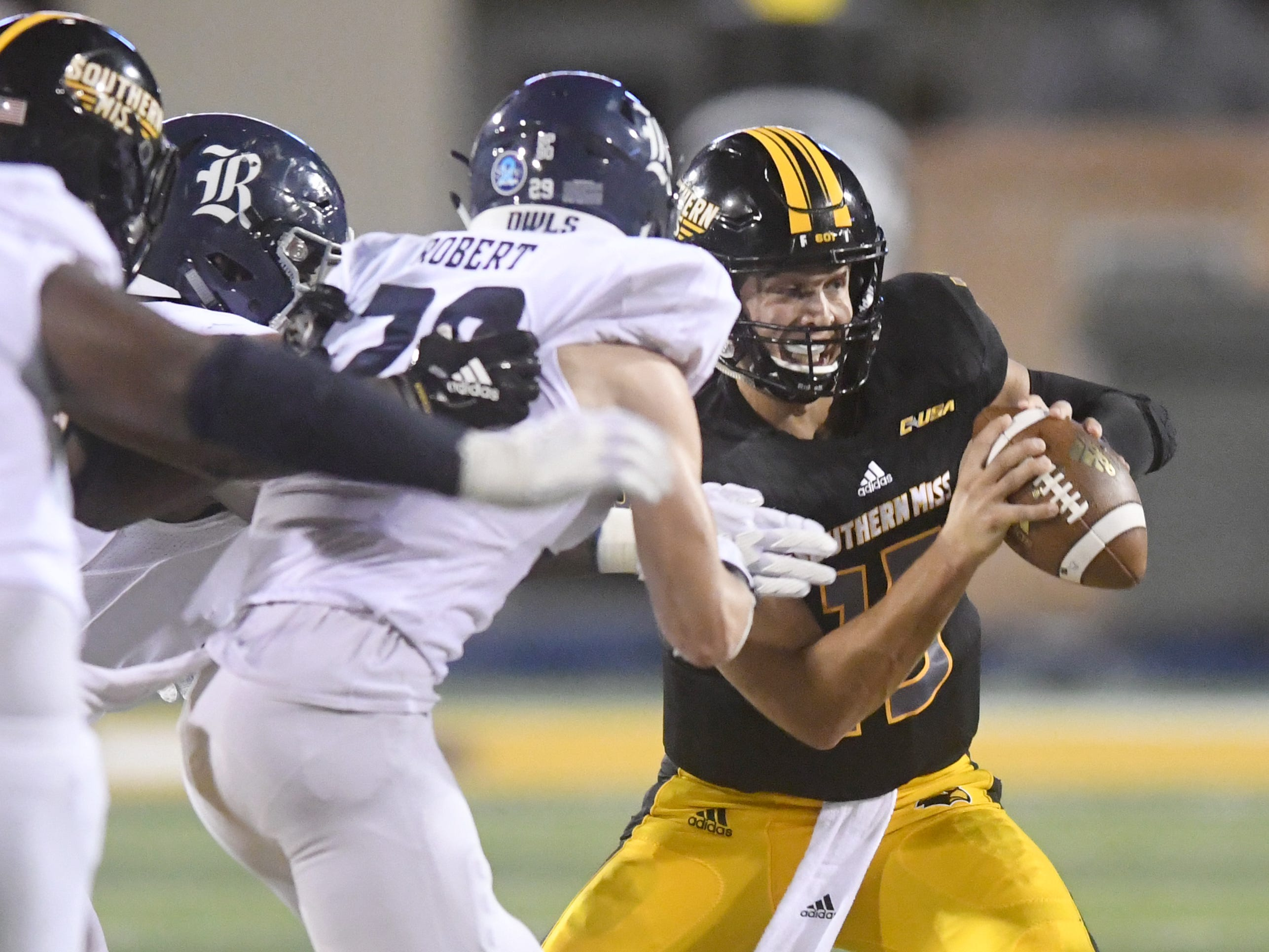Southern Miss quarterback Jack Abraham runs from a tackle in a game against Rice at M.M. Roberts Stadium on Saturday, September 22, 2018.
